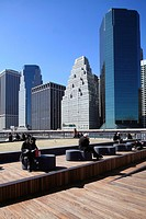 The boardwalk of South Street Seaport with the high-rise office towers of Financial District in the background  New York City  New York  USA