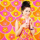 Smiling Hispanic woman in nostalgic dress drinking milkshake