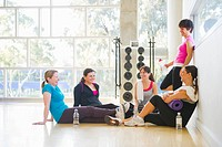 Women talking together after exercise class