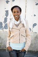 Smiling woman with hands in pockets