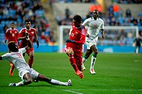 23 04 2012 Coventry, England Pape Ndiaye Souare Senegal / Lille tackles Waleed Al Saadi Oman during the Olympic Qualifying match between Senegal and O...