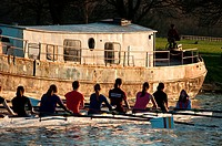 Rowers at sunset on river Cam near Cambridge, England