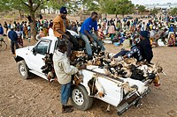 Livestock market. Goats and chickens being transported from a rural livestock market to urban areas. The lack of infrastructure and proper transportat...
