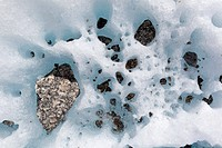 Cryoconite holes. Close_up of cryoconite holes on a glacier. A cryoconite hole forms when dust is deposited in ice or snow. The deposit is darker and ...