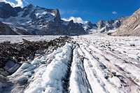 Forno glacier. View over longitudinal foliation ridges and medial moraine accumulated debris, left on the surface of the Forno glacier, Switzerland. T...