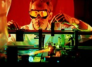 Dye laser. Researcher using a tabletop dye laser used to operate an atomic clock. ´Laser´ is an acronym of Light Amplification by Stimulated Emission ...