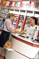 Woman talking to a pharmacist at a pharmacy