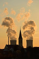 Church of Roethlein in front of Grafenrheinfeld nuclear power plant, silhouetted at dusk, Schweinfurt, Bavaria, Germany, Europe