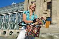 Woman riding a bike to do her shopping