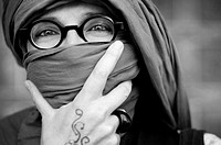 Close up of a woman portrait with glasses and hijab