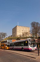 Buses waiting at the traffic lights with the castle behind in Norwich , Norfolk , England , Britain , Uk