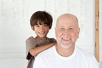 Father and son smiling together