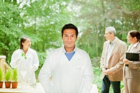 Scientist standing in meeting outdoors