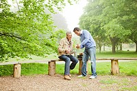 Men talking in park