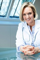 Smiling doctor sitting at desk