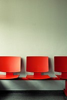 Waiting room with red chairs