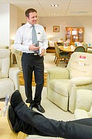 Salesman at work in furniture store