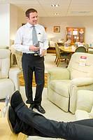 Salesman at work in furniture store