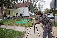 Detroit, Michigan - A photographer documents the procgress as students from the University of Michigan School of Art & Design decorate an abandoned ho...
