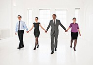 Business people holding hands in office
