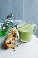 Jug of cucumber trout soup with sandwich
