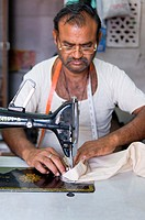 A tailor sews clothing in Jodhpur, India