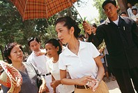 Princess Rattana Norodom of Cambodia handing out alms and interacting with the poor people in the villages of Cambodia