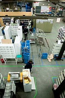 Picture shows belgian post employees as they work in sorting center with postbags filled with certified mail / letters / packages before daily round c...