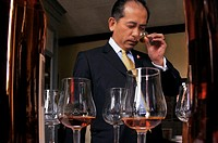 France, Midi Pyrenées, Gers, Mr Nelson Chow, the famed sommelier from China, tasting Armaganc, at the ´Dartigalongue Armagnac Estate´, at Nogaro