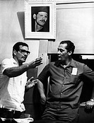 The policeman Euclides Nascimiento, alleged leader of death squads in Brazil, speaking with a colleague under the portrait of Milton Le Cocq, founder ...