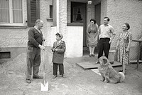Giuseppe Baruffolo and his family in front of their house inNiederkassel between Bonn and Cologne. Giuseppe Baruffolo was bornin Belluno and resides i...