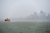 Staten Island Ferry and thunderstorms over Manhattan, New York, USA