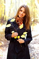 attractive girl in the autumn forest