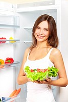 Young woman with healthy salad.