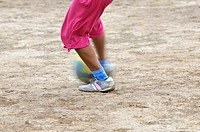 Girl playing soccer, detailed view of the feet with the ball, indigenous community of La Curvita, called Hothaj in the language of the Wichi Indians, ...