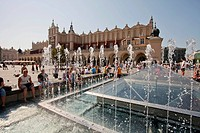Main market square, Sukiennice or Cloth Hall, fountains, Krakow, Poland, Europe