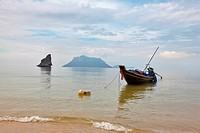Thai Longtal boat moored on a beach