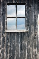window in wood wall