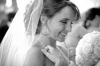 black and white horizontal photograph of a smiling bride