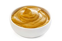 Mustard in small white bowl. Clipping path included.
