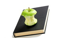 bitten apple on book
