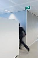 Businessman rushing towards the exit door
