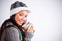 A shot of a happy beautiful asian woman drinking coffee