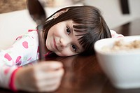 Little girl at breakfast table