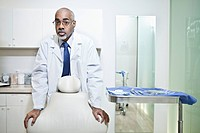 Portrait of male dentist in office