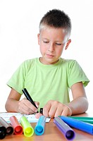 child draws is family on white paper by colour pensil