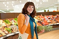 Woman shopping in supermarket (thumbnail)