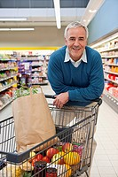 Portrait of middle_aged man shopping in supermarket