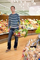 Man shopping in vegetable department