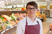 Portrait of salesman standing in supermarket
